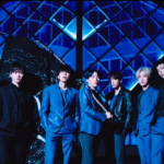 D-CRUNCH wave flags for their return in two MV teasers for 'Across The Universe'!