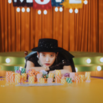 IU plays her hand for 'Coin' ahead in a comeback MV teaser!
